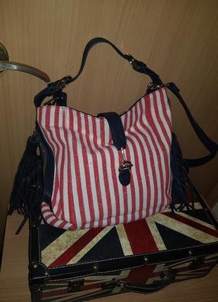 Модная сумка в полоску с кисточками