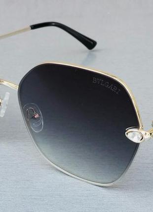 Bvlgari очки женские солнцезащитные серые в металлической золотой оправе