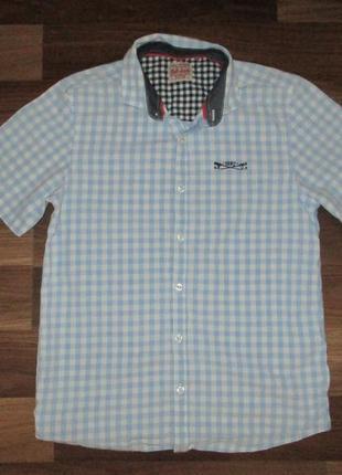 Голубенькая котоновая в клетку рубашка фирмы некст на 12 лет