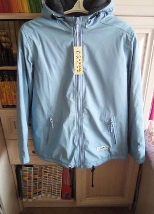 Куртка  женская 38 - 40 р евро ( наш 44-46-48 ) новая . непродуваемая и непромокаемая.