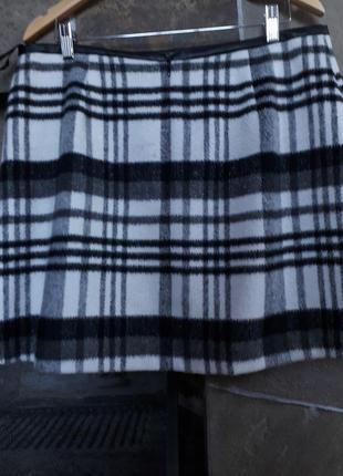 Фирменная теплая юбка в состоянии новой. 50-52р