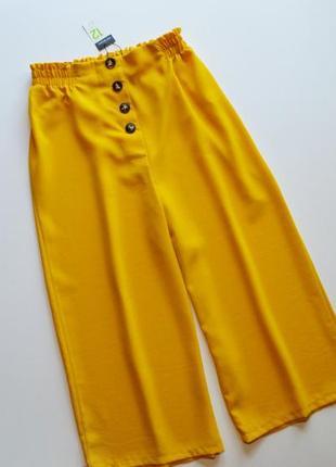 Стильные желтые брюки кюлоты