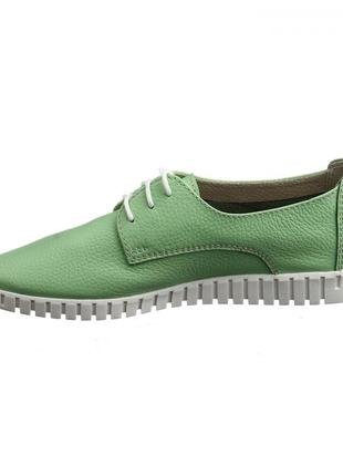 Зеленые кожаные кеды