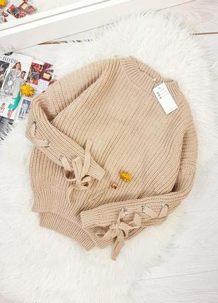 Бежевый свитер крупной вязки светер