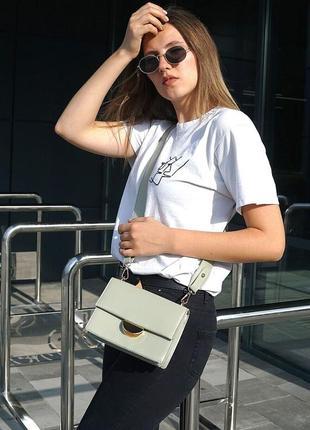 Женская сумочка, женская сумочка с широкой длинной ручкой.