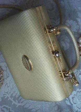 Золотая сумочка саквояж versace
