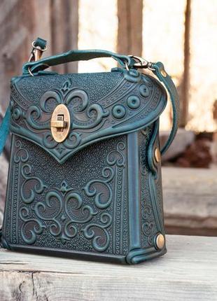 Сумочка-рюкзак шкіряна жіноча темно-зелена з орнаментом