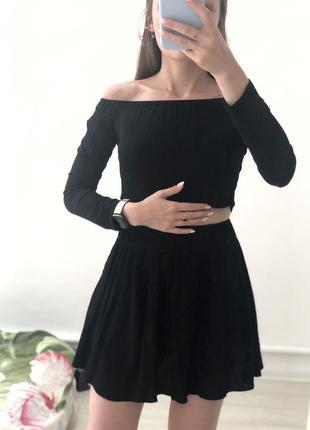 Черная расклешенная юбочка