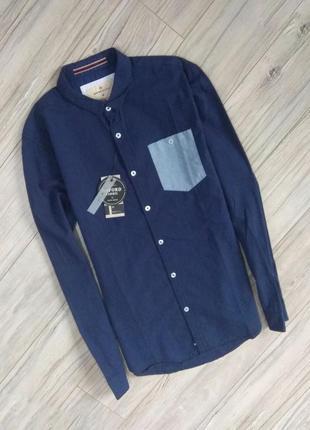 Новая с бирками мужская   рубашка  синего цвета- светлый карман, м размер
