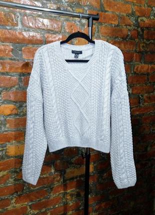 Стильный вязаный свитер с косами atmosphere