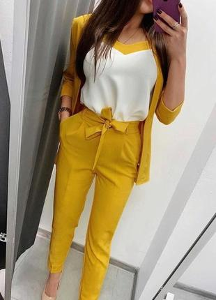 Трендовые брюки горчичного цвета