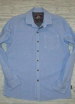 Плотная голубенькая котоновая рубашка фирмы некст на 9 лет(по бирке на 10)