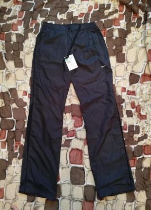 Женские спортивные болоневые штаны от бренда nike. размер s
