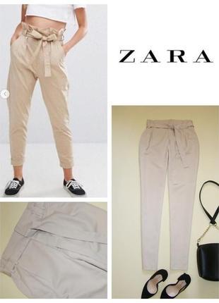 Актуальные бежевые брюки со складками на талии и высокой посадкой zara