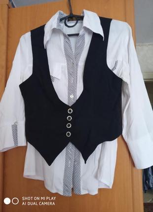 Блузку и жилетка