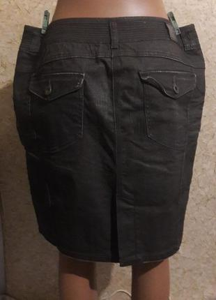 Стильная джинсовая юбка с пропиткой, которая немного переливается5 фото