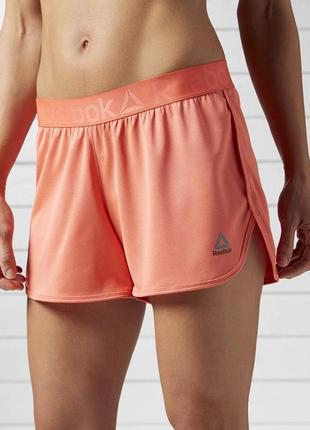 Спортивные шорты reebok кораллового цвета