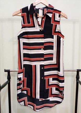 Блуза с удлиненной спинкой и разрезами по бокам