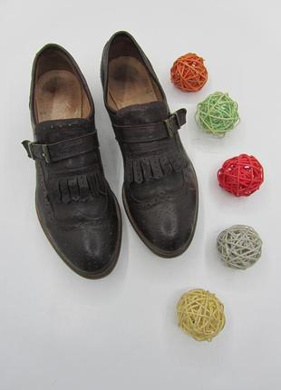 Кожаные туфли с бахромой и перфораціей