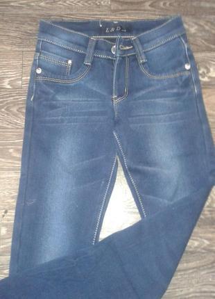 Утепленные джинсы на девочку2 фото