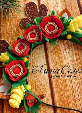 Рожки оленя с цветами на ободке