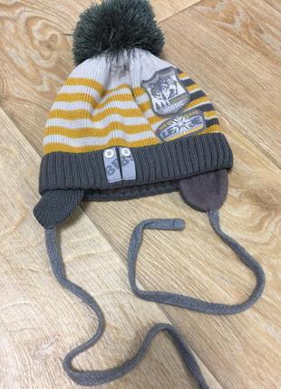 Зимняя теплея шапка