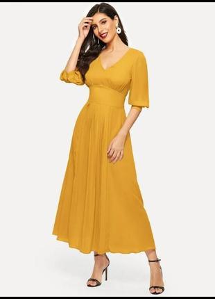 Желтое платье клеш