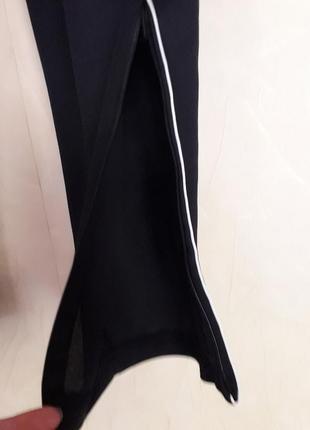 Спортивные зауженные брюки adidas унисекс4 фото