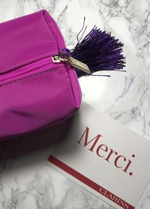Косметичка яркая фиолетовая clarins