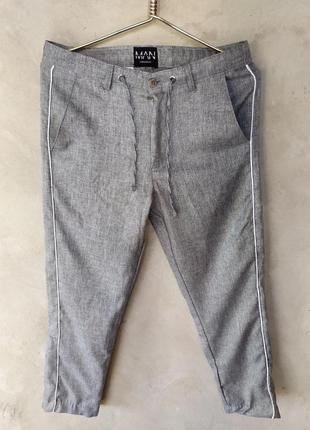 Стильные брюки с лампасами по бокам