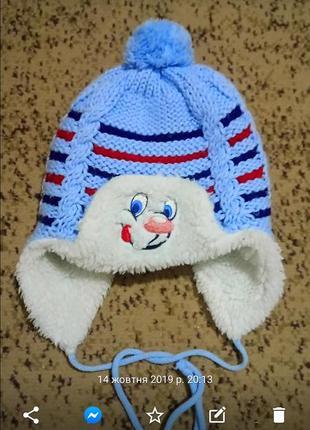Вязана зимова шапка-вушанка(вязаная зимняя шапка-ушанка)