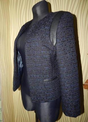 Теплый жакет из пальтовой ткани без застежки.