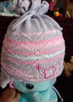 Теплая зимняя шапка на овчине.