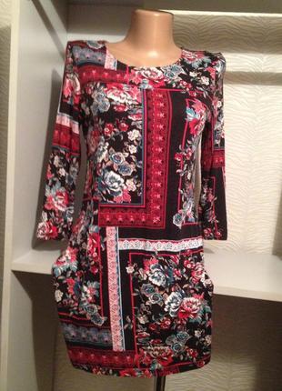 Коротенькое трикотажное платье.