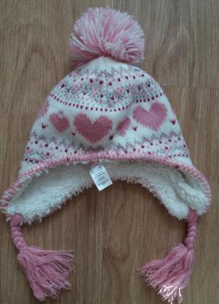 Теплая и красивая шапка для девочки matalan.