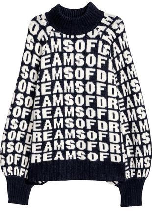 Теплый жаккардовый свитер в широкими рукавами тренд