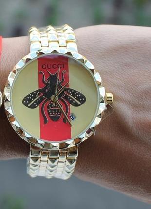 Новые стильные часы металлические, золотистые
