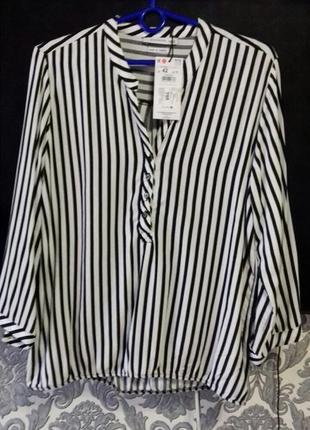 Рубашка фирмы reserved 42  евро