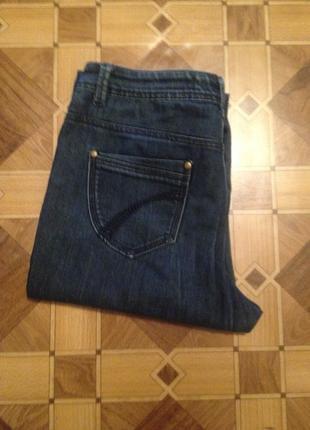 Оригинальные  джинсы с потертостями большого размера.066
