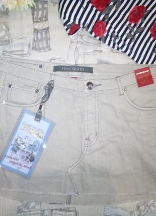 Новая короткая джинсовая юбка с необработанным низом