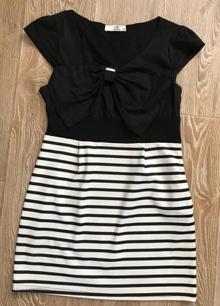 Платье в полоску с бантом