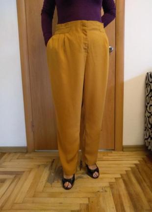 Стильные брючки с карманами. размер 24