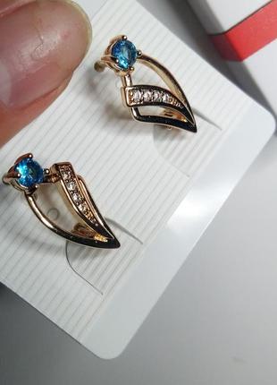 Позолоченые серьги с голубым фианитом