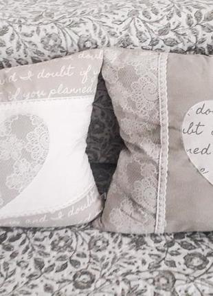 2 декоративні подушечки