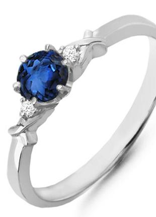 Золотое кольцо с сапфиром и бриллиантами 0,04 карат 17 мм. белое золото. новые