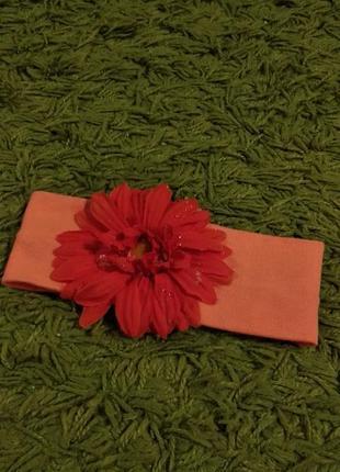 Коралловая лента на голову с цветком