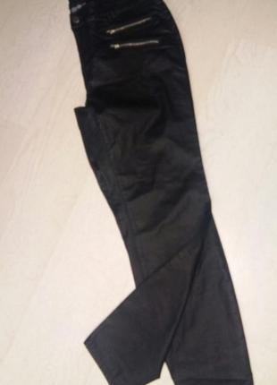 Новые брюки под кожу 42 размер.