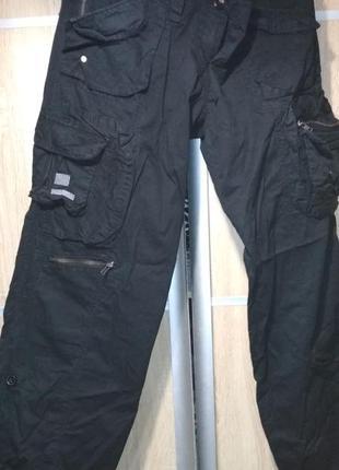 Женские брюки карго черного цвета . большого размера
