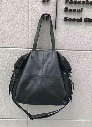 Дорожная кожаная сумка