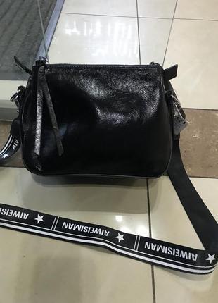 Кожаная сумка сумка кожаная и чёрная  с лазерным напыление